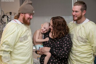 """Boston Red Sox pitchers Robbie Ross Jr. and Craig Kimbrel visit a patient at Massachusetts General Hospital during the Holiday Caravan in Boston, Massachusetts Friday, December 10, 2015."""