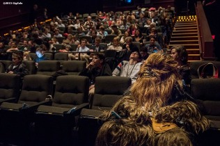 """Chewbacca sits in a theatre with guests during an advanced screening of 'Star Wars: The Force Awakens' for Goldman Sachs at Loews Theatre in Boston, Massachusetts Thursday, December 17, 2015."""