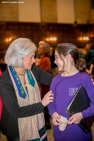 """Rabbi Elaine Zecher greets guests at an Oneg following Qabbalat Shabbat services at Temple Israel in Boston, Massachusetts Friday, January 15, 2016."""