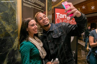 """Boston Red Sox shortstop Xander Bogaerts poses for a selfie photograph with a fan during the 2016 Winter Weekend at Foxwoods Resort & Casino in Ledyard, Connecticut Saturday, January 23, 2016."""