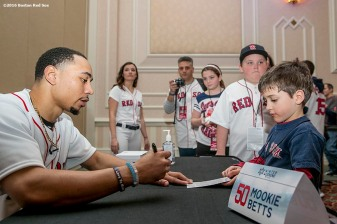 """Boston Red Sox outfielder Mookie Betts signs autographs at the 2016 Winter Weekend at Foxwoods Resort & Casino in Ledyard, Connecticut Saturday, January 23, 2016."""