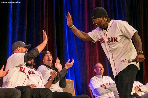"""Boston Red Sox left fielder Hanley Ramirez high fives third baseman Travis Shaw during a game show at the 2016 Winter Weekend at Foxwoods Resort & Casino in Ledyard, Connecticut Saturday, January 23, 2016."""