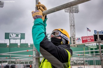 """A worker installs beams as progress begins on construction of the Big Air ski and snowboard ramp at Fenway Park in Boston, Massachusetts Tuesday, January 19, 2016."""