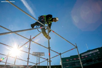"""A worker constructs scaffolding as construction continues on the Big Air at Fenway ski and snowboard ramp at Fenway Park in Boston, Massachusetts Wednesday, January 20, 2016. """
