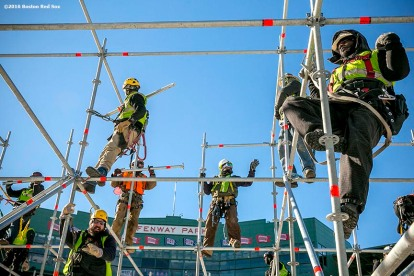 """Workers construct scaffolding as construction continues on the Big Air at Fenway ski and snowboard ramp at Fenway Park in Boston, Massachusetts Wednesday, January 20, 2016."""