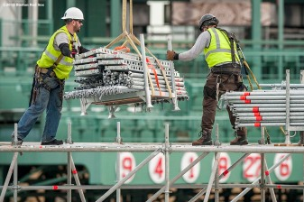 """Workers move scaffolding as construction continues on the Polartec Big Air at Fenway ski and snowboard ramp at Fenway Park in Boston, Massachusetts Tuesday, January 26, 2016. """