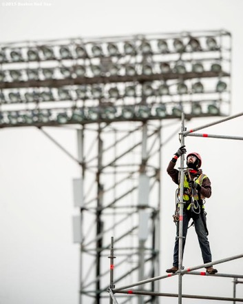 """A worker builds scaffolding as construction continues on the Polartec Big Air at Fenway ski and snowboard ramp at Fenway Park in Boston, Massachusetts Tuesday, January 26, 2016."""
