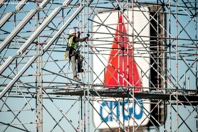 """A worker builds scaffolding as construction continues on the Polartec Big Air at Fenway ski and snowboard ramp at Fenway Park in Boston, Massachusetts Thursday, January 28, 2016."""