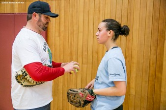 """Former Boston Red Sox catcher Jason Varitek gives pitching instructions to a participant during a clinic Dexter High School in Brookline, Massachusetts Monday, February 2, 2016."""