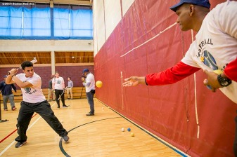 """A participant takes batting practice during a clinic Dexter High School in Brookline, Massachusetts Monday, February 2, 2016. """