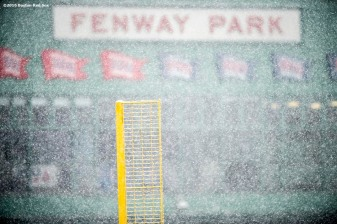"""Pesky Pole is shown as snow falls at Fenway Park in Boston, Massachusetts Friday, February 5, 2016."""