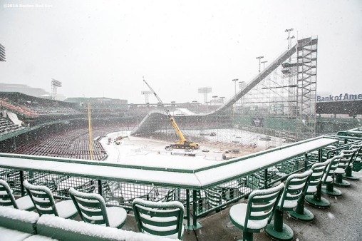 """Construction continues on the Polartec Big Air ski and snowboard ramp as snow falls at Fenway Park in Boston, Massachusetts Friday, February 5, 2016. """