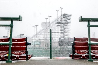 """Construction continues on the Polartec Big Air ski and snowboard ramp as snow falls at Fenway Park in Boston, Massachusetts Friday, February 5, 2016."""