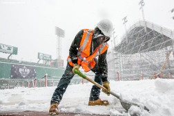 """A worker shovels snow as construction continues on the Polartec Big Air ski and snowboard ramp as snow falls at Fenway Park in Boston, Massachusetts Friday, February 5, 2016. """