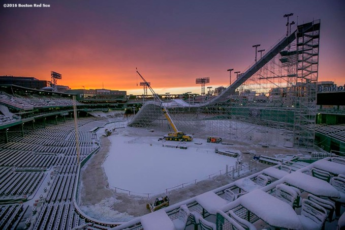 """The sun sets as construction continues on the Polartec Big Air ski and snowboard ramp at Fenway Park in Boston, Massachusetts Friday, February 5, 2016."""