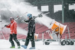 """Volunteers prepare snow on the Polartec Big Air ski and snowboard ramp at Fenway Park in Boston, Massachusetts Monday, February 8, 2016."""