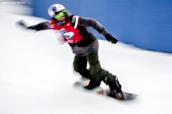 """""""A snowboarder prepares to jump off the ramp during the Polartec Big Air at Fenway ski and snowboard competition at Fenway Park in Boston, Massachusetts Wednesday, February 10, 2016."""""""