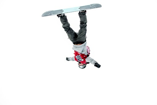 """A snowboard rider jumps off the ramp during the Polartec Big Air at Fenway ski and snowboard competition at Fenway Park in Boston, Massachusetts Wednesday, February 10, 2016."""