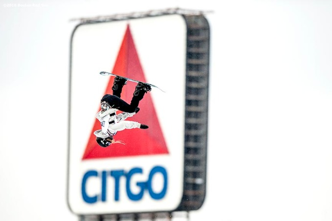 """Snowboarder Julie Marino jumps off the ramp as the Citgo sign is shown during the Polartec Big Air at Fenway ski and snowboard competition at Fenway Park in Boston, Massachusetts Wednesday, February 10, 2016. Marino went on to win the competition."""