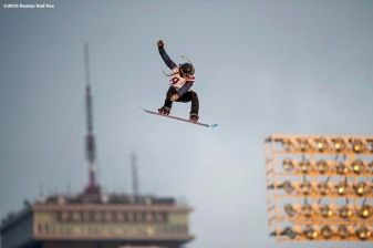 """A snowboard rider jumps off the ramp as the Prudential Center is shown during the Polartec Big Air at Fenway ski and snowboard competition at Fenway Park in Boston, Massachusetts Wednesday, February 10, 2016."""