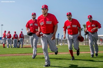 """Boston Red Sox pitchers Brandon Workman, Eduardo Rodriguez, David Price, and Matt Barnes switch fields during a workout at JetBlue Park in Fort Myers, Florida Saturday, February 20, 2016."""