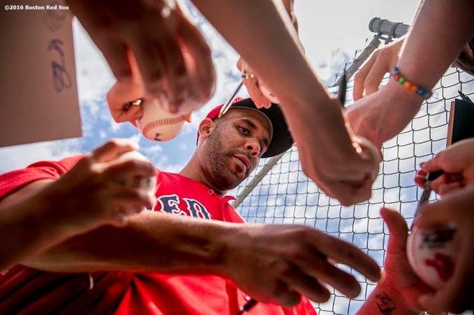 """Boston Red Sox pitcher David Price signs autographs during a workout at JetBlue Park in Fort Myers, Florida Saturday, February 20, 2016."""