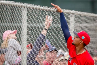FT. MYERS, FL - FEBRUARY 23: Xander Bogaerts #2 of the Boston Red Sox hands a ball to a fan during a team workout on February 23, 2016 at Fenway South in Fort Myers, Florida . (Photo by Billie Weiss/Boston Red Sox/Getty Images) *** Local Caption *** Xander Bogaerts