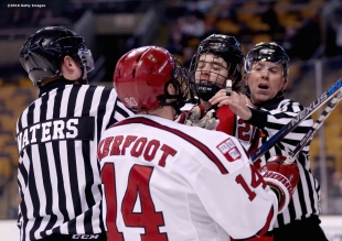 BOSTON, MA - FEBRUARY 08: Alexander Kerfoot #14 of Harvard University fights with Nolan Stevens #21 of Northeastern University during the second period of the Beanpot Tournament consolation game at TD Garden on February 8, 2016 in Boston, Massachusetts. (Photo by Billie Weiss/Getty Images) *** Local Caption *** Alexander Kerfoot;Nolan Stevens