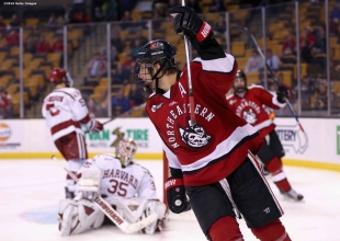 of Northeastern University of Harvard University during the period of the Beanpot Tournament consolation game at TD Garden on February 8, 2016 in Boston, Massachusetts.