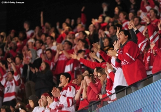 BOSTON, MA - FEBRUARY 08: Fans of Boston University cheer during the Beanpot Tournament championship game against Boston College at TD Garden on February 8, 2016 in Boston, Massachusetts. (Photo by Billie Weiss/Getty Images)
