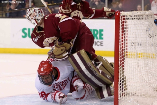 BOSTON, MA - FEBRUARY 08: Jordan Greenway #18 of Boston University runs into Thatcher Demko #30 of Boston College during the third period of the Beanpot Tournament championship game at TD Garden on February 8, 2016 in Boston, Massachusetts. (Photo by Billie Weiss/Getty Images) *** Local Caption *** Jordan Greenway;Thatcher Demko