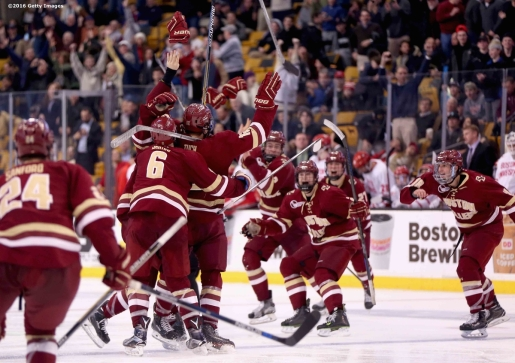 BOSTON, MA - FEBRUARY 08: Teammates mob Alex Tuch #12 of Boston College after he scored a game winning goal in overtime to defeat Boston University in the Beanpot Tournament championship game at TD Garden on February 8, 2016 in Boston, Massachusetts. (Photo by Billie Weiss/Getty Images) *** Local Caption *** Alex Tuch