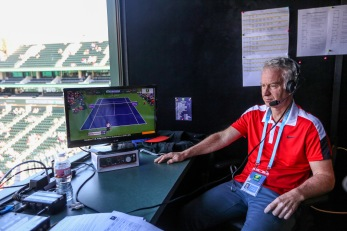 """John McEnroe joins the BBC Radio booth during the 2016 BNP Paribas Open at the Indian Wells Tennis Garden in Indian Wells, California Saturday, March 12, 2016."""