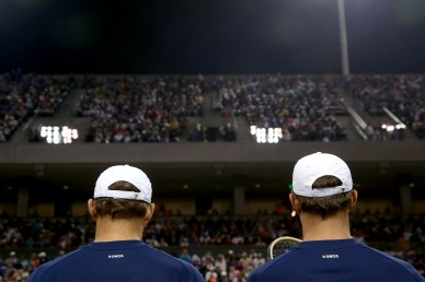 """Bob and Mike Bryan sit before a doubles match against Frenando Verdasco and Rafael Nadal during the 2016 BNP Paribas Open at the Indian Wells Tennis Garden in Indian Wells, California Saturday, March 12, 2016."""