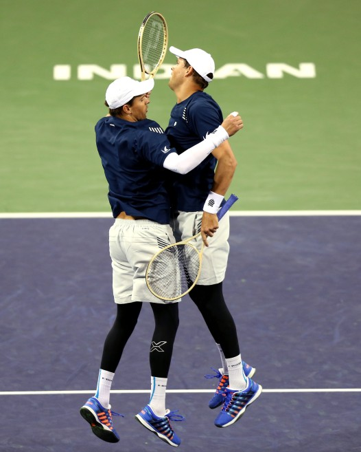 """Bob and Mike Bryan in action against Frenando Verdasco and Rafael Nadal during the 2016 BNP Paribas Open at the Indian Wells Tennis Garden in Indian Wells, California Saturday, March 12, 2016."""