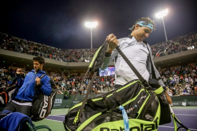 """Fernando Verdasco and Rafael Nadal are introduced before a doubles match against Bob and Mike Bryan, during the 2016 BNP Paribas Open at the Indian Wells Tennis Garden in Indian Wells, California Saturday, March 12, 2016."""