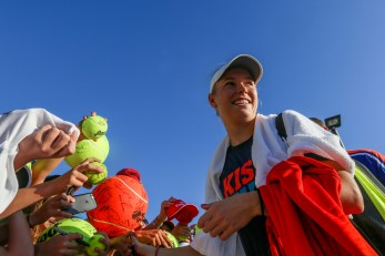 """Caroline Wozniacki signs autographs during the 2016 BNP Paribas Open at the Indian Wells Tennis Garden in Indian Wells, California Saturday, March 12, 2016."""
