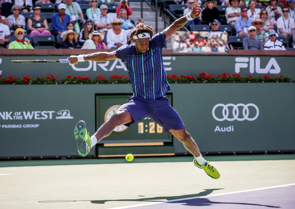 """Gael Monfils in action against Pablo Carreno Busta during the 2016 BNP Paribas Open at the Indian Wells Tennis Garden in Indian Wells, California Saturday, March 12, 2016."""