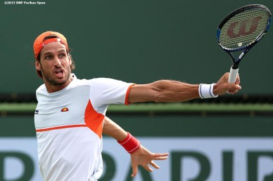 """Feliciano Lopez in action against Guillermo Garcia-Lopez during the 2016 BNP Paribas Open at the Indian Wells Tennis Garden in Indian Wells, California Sunday, March 13, 2016."""