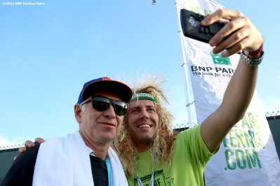 """John McEnroe greets guests at the We Are Tennis BNP Paribas Fan Academy at the Tennis Warehouse Demo Court during the 2016 BNP Paribas Open at the Indian Wells Tennis Garden in Indian Wells, California Sunday, March 13, 2016."""