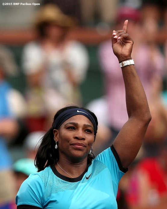 """""""Serena Williams reacts after defeating Yulia Putintseva during the 2016 BNP Paribas Open at the Indian Wells Tennis Garden in Indian Wells, California Sunday, March 13, 2016."""""""