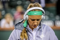 """Victoria Azarenka warms up before a match against Shuai Zhang during the 2016 BNP Paribas Open at the Indian Wells Tennis Garden in Indian Wells, California Monday, March 14, 2016."""