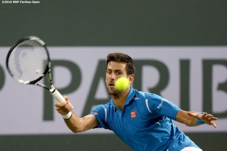 """Novak Djokovic in action during a match against Phillip Kohlschreiber during the 2016 BNP Paribas Open at the Indian Wells Tennis Garden in Indian Wells, California Tuesday, March 15, 2016."""