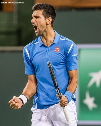 """Novak Djokovic reacts during a match against Phillip Kohlschreiber during the 2016 BNP Paribas Open at the Indian Wells Tennis Garden in Indian Wells, California Tuesday, March 15, 2016."""
