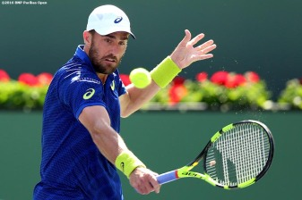 """Steve Johnson in action against Kei Nishikori during the 2016 BNP Paribas Open at the Indian Wells Tennis Garden in Indian Wells, California Tuesday, March 15, 2016."""