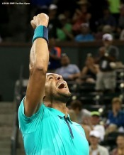 """Jo-Wilfried Tsonga reacts during a match against Sam Querrey during the 2016 BNP Paribas Open at the Indian Wells Tennis Garden in Indian Wells, California Tuesday, March 15, 2016."""