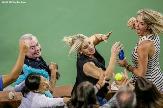 """Fans reach for a stray tennis ball during the 2016 BNP Paribas Open at the Indian Wells Tennis Garden in Indian Wells, California Tuesday, March 15, 2016."""