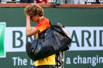 """Alexander Zverev reacts after being defeated by Rafael Nadal during the 2016 BNP Paribas Open at the Indian Wells Tennis Garden in Indian Wells, California Wednesday, March 16, 2016."""