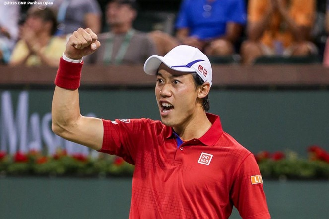 """Kei Nishikori reacts after defeating John Isner during the 2016 BNP Paribas Open at the Indian Wells Tennis Garden in Indian Wells, California Wednesday, March 16, 2016."""