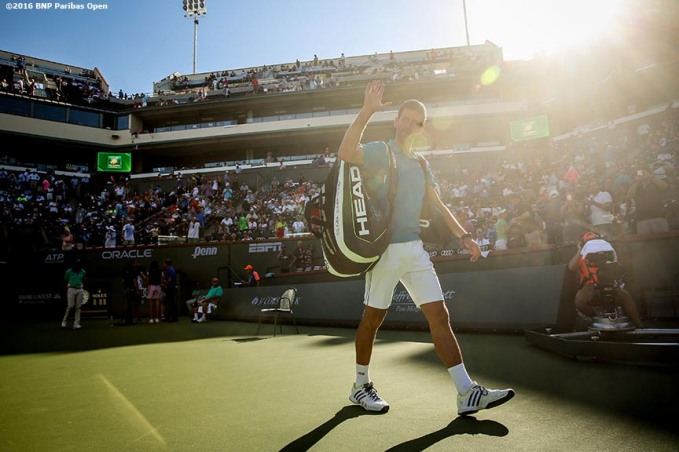 March 18, 2016, Palm Springs, CA: Novak Djokovic walks off court after winning a quarter-final match against Jo-Wilfried Tsonga during the 2016 BNP Paribas Open at the Indian Wells Tennis Garden in Indian Wells, California Friday, March 18, 2016. (Photos by Billie Weiss/BNP Paribas Open)